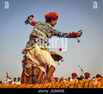 PUSHKAR, INDIA - MAR 7, 2012. Rajasthani folk dancers in colorful ethnic attire perform in Pushkar, India. Pushkar - Stock Photo
