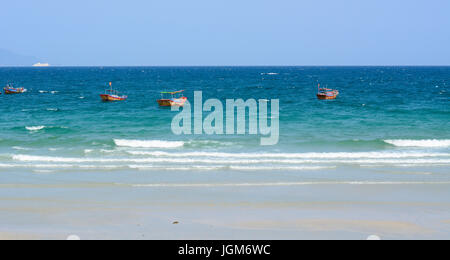 Wooden boats on blue sea at summer day in Nha Trang, Vietnam. - Stock Photo