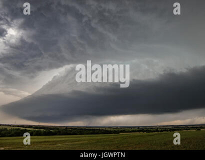 Bell shaped updraft of rotating supercell over rural area, Chester, Oklahoma, United States, North America - Stock Photo