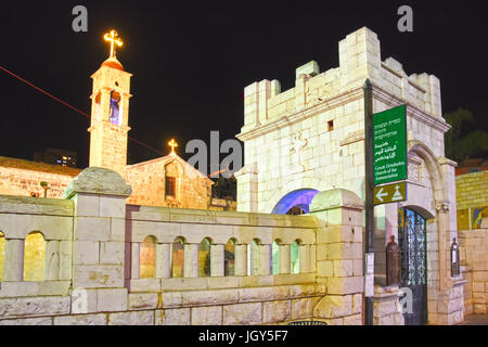 Greek Orthodox Church of the Annunciation in Nazareth at night - Stock Photo