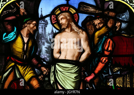 St Paul church. Stained glass window. The Flagellation of Christ.  Lyon. France. - Stock Photo