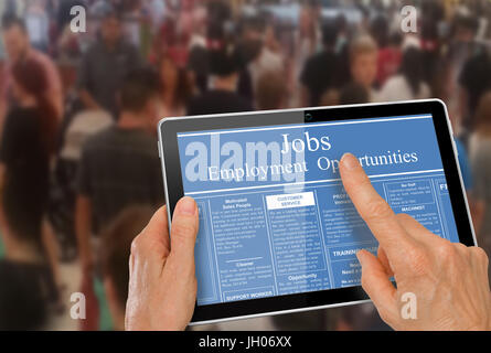 Online job hunting Hands with computer tablet reading employment ads in front of crowd of people - Stock Photo