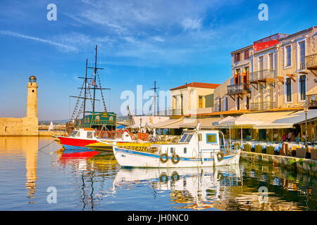 Old Venetian Port, lighthouse in the background, Rethymno, Crete Island, Greece - Stock Photo