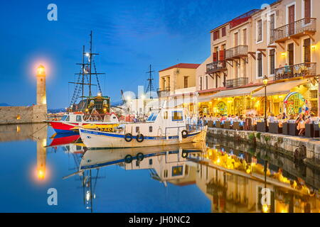 Evening at Old Venetian Port, lighthouse in the background, Rethymno, Crete Island, Greece - Stock Photo