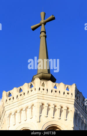 Cross. Justice. Crenellated octagonal tower. Basilica of Notre-Dame de Fourvire. Lyon. - Stock Photo