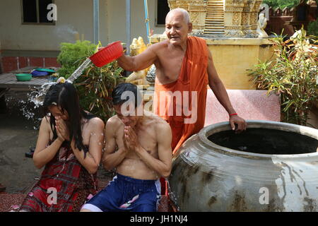 Monk blessing a couple. Cambodia. - Stock Photo