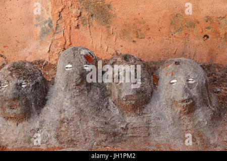 Voodoo fetishes at the entrance of a convent. Togoville, Togo. - Stock Photo