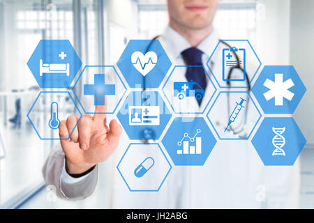 Medical doctor touching icons of health care services on a digital screen, with hospital interior background - Stock Photo