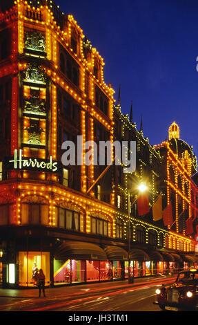 Harrods department store at night. London. England. UK. Circa 1989 - Stock Photo