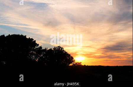 Sunset over Upper Chancton Farm, West Sussex, UK - Stock Photo