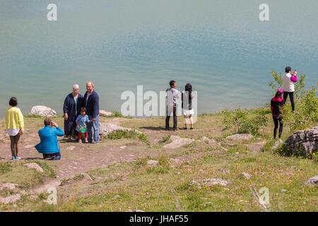 Tourists are taking photos at Medicine Lake in Jasper National Park, Alberta, Canada - Stock Photo
