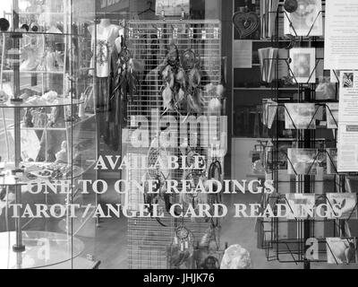 Available one to one readings, Tarot and Angel card readings sign in shop window, used to predict the future - Stock Photo