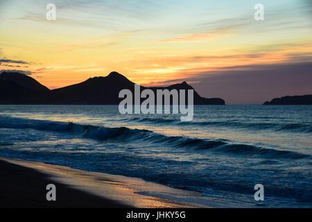 Sunrise over the headland to the east of Vila Baleira in Porto Santo Island, Madeira, Portugal - Stock Photo