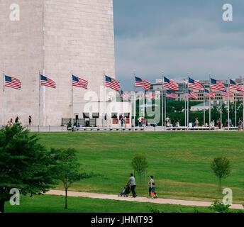 WASHINGTON DC, USA - June, 2017: American flags at the Washington Monument are an obelisk, built to commemorate - Stock Photo