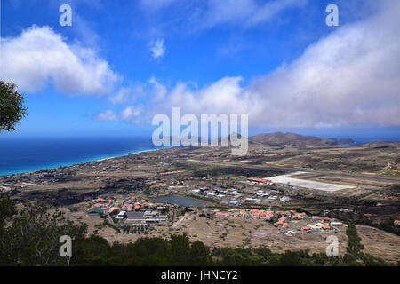 View of the town of Vila Baleira, Ilheu da Cal and International Airport from Pico do Castelo on Portuguese Atlantic - Stock Photo