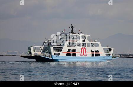 Hiroshima, Japan - Dec 28, 2015. Tourist boat carrying passengers to Miyajima Island in Hiroshima, Japan. Miyajima - Stock Photo