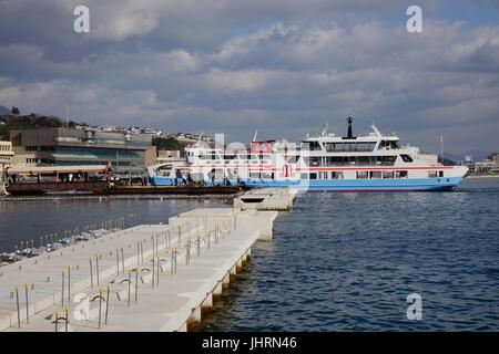 Hiroshima, Japan - Dec 28, 2015. Tourist boat at pier to Miyajima Island in Hiroshima, Japan. Miyajima is famous - Stock Photo