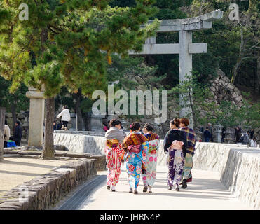 Hiroshima, Japan - Dec 28, 2015. Women in kimono walking on street in Miyajima island, Japan. Miyajima is famous - Stock Photo