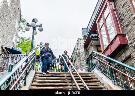 Quebec City, Canada - May 30, 2017: People walking down famous stairs or steps on lower old town street called Rue - Stock Photo