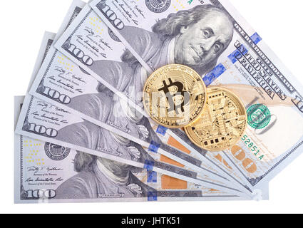 Golden Bitcoins on US dollars. Electronic money exchange concept - Stock Photo