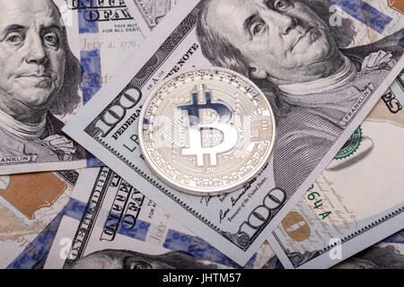 Silver bitcoins on US dollars. Electronic money exchange concept - Stock Photo