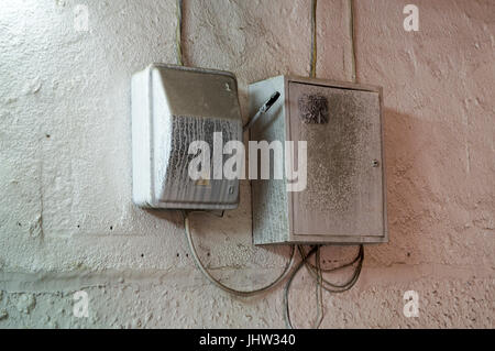 The junction box on a concrete wall - Stock Photo