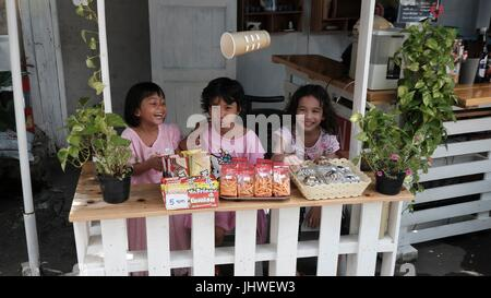 Three Little Girls Playing at Their Lemonade Stand Selling Snacks in Bang Rak Bangkok Thailand - Stock Photo