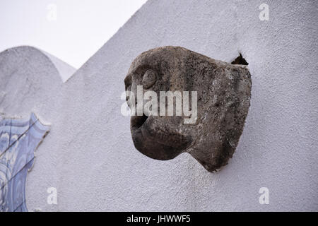Gargoyles on the side wall of Igreja de Nossa Senhora da Piedade church in Vila Baleira, Porto Santo, Portugal - Stock Photo