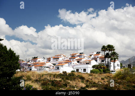 A view of a housing development in Alumenecar, Andalusia, Spain, Costa del Sol, Mediterranean, Spain. - Stock Photo