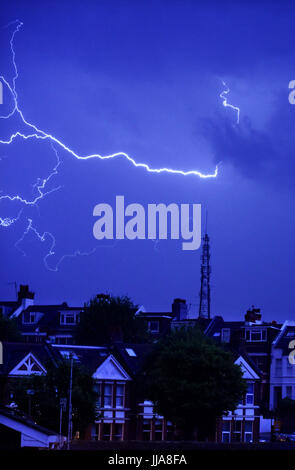 Brighton, UK. 19th July, 2017. Lightning over the television mast on Whitehawk Hill in East Brighton and homes in - Stock Photo