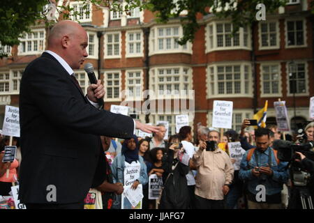 London, UK. 19th July 2017. A crowd of around 300 listens to speakers at a rally.  Protests take place outside the - Stock Photo