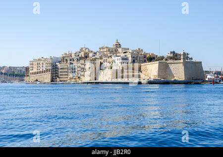 The view of Senglea peninsula from Grand Harbour with Fort Saint Michael and the Guard tower on the tip of the bastions - Stock Photo