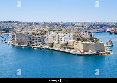 Senglea peninsula as seen from the Upper Barrakka Gardens with its waterfront the St.Philip's Chapel dome, bastions - Stock Photo