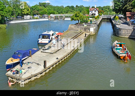 Looking down from above at approach to Goring Lock on River Thames in Oxfordshire & weir with Streatley & moored - Stock Photo