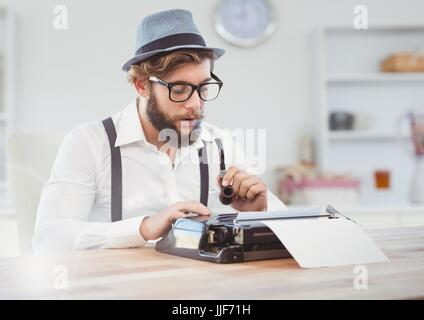 Digital composite of Hipster man  on typewriter in bright room - Stock Photo
