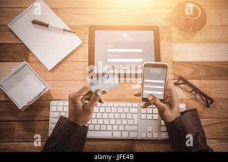 Online banking against close up of businessman doing online shopping on mobile phone - Stock Photo