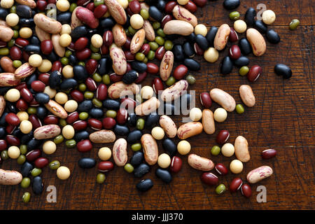 Mixed dry beans on dark wood from above. - Stock Photo