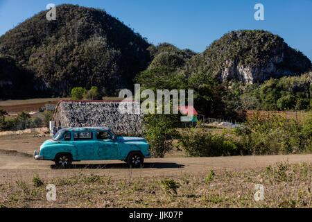Vintage American cars are a common site - VINALES, PINAR DEL RIO, CUBA - Stock Photo