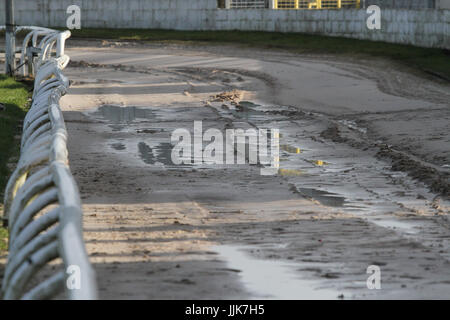 Waterlogged greyhound track requiring work after heavy rain. - Stock Photo