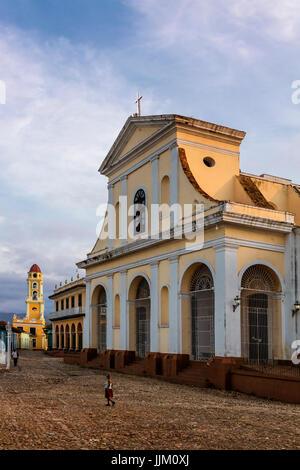 The IGLESIA PARROQUIAL DE LA SANTISIMA TRINIDAD is located on PLAZA MAYOR - TRINIDAD, CUBA - Stock Photo