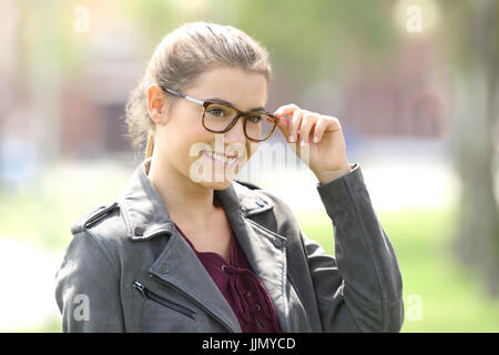 Beautiful woman wearing eyeglasses and walking in the street - Stock Photo