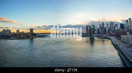 Manhattan Bridge and NYC Skyline  Sunset - Stock Photo