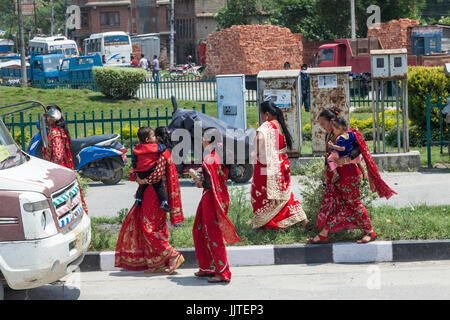Women in colourful dresses on street of General street scenes in Kathmandu and Durbar Square,,Nepal,Himalaya, - Stock Photo