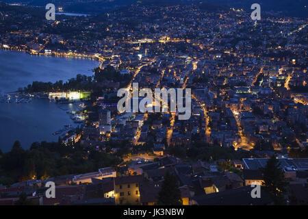 Switzerland, Ticino, Lake Lugano, Lugano, town view from Monte Bre, dusk - Stock Photo
