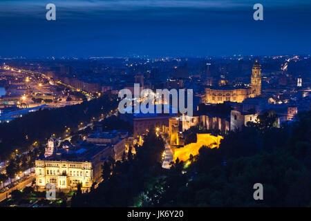 Spain, Andalucia Region, Malaga Province, Malaga, elevated town view with cathedral, evening - Stock Photo