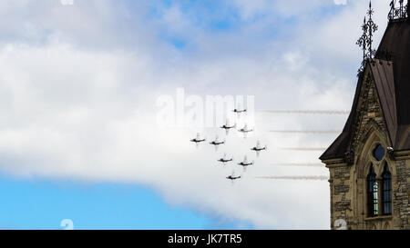 CF Snowbird flypast the Peace Tower of the Parliament Buildings to celebrate Canada Day, Ottawa, Capital of Canada - Stock Photo