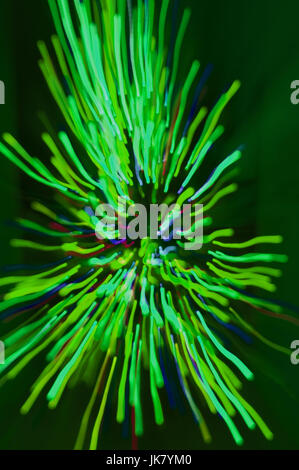 explosion of lights, taken by zooming in on a Christmas Tree, then changing color on Photoshop - Stock Photo