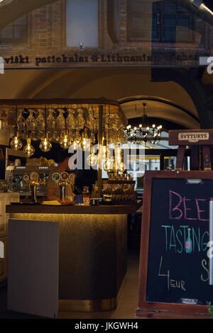 Bar counter of one of the restaurants on Pilies Street. Vilnius, Lithuania. - Stock Photo