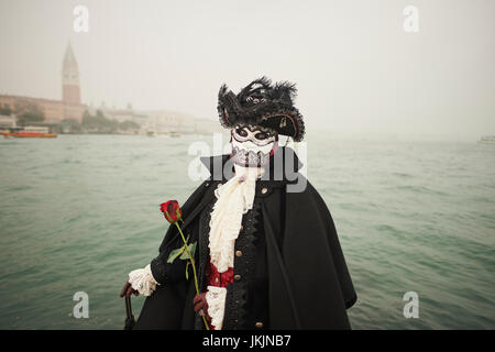 Female Bauta Mask with Coat - Stock Photo