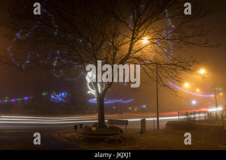 Winter night street scene with Christmas  lights - Stock Photo